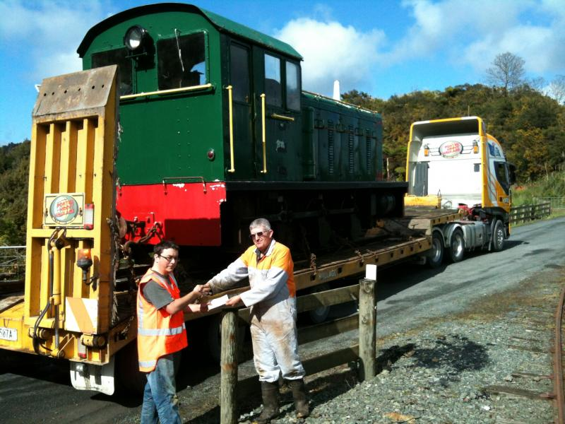 Official handover of the locomotive once safely loaded onto the truck - Trust Chairperson Ben Calcott hands cheque to Bruce McLuckie.