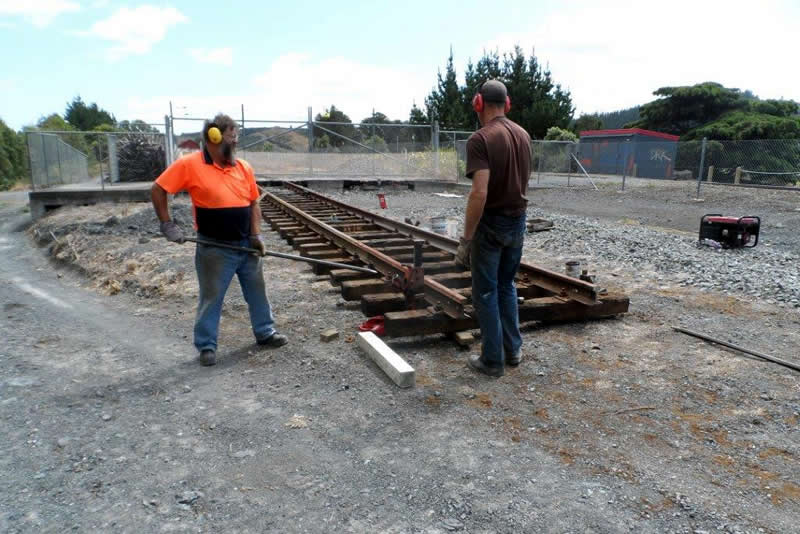 Ray and Hugh bring track to level after fitting sleepers