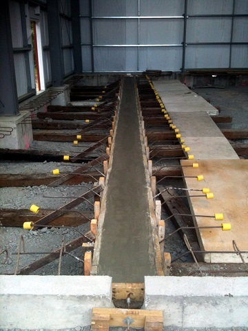 Rail beam concrete placed