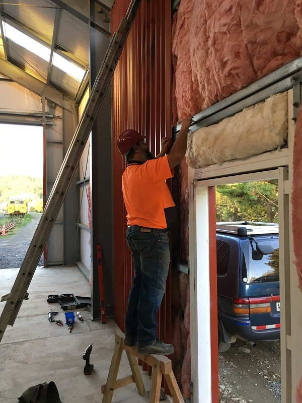 Ray working on the internal lining of the workshop on 7 May