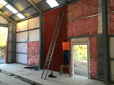 Ray fitting cladding to workshop wall